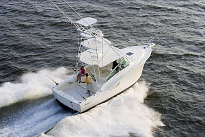 Couple on the aftdeck of a sportsfisher.  Model and property released. - Billy Black