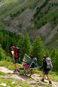 Hiking with handicapped person in the Alps, France, July 2008  -  Jean E. Roche