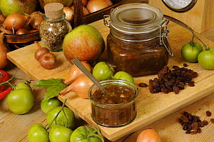 Country kitchen scene of home made Green Tomato Chutney, showing ingedients and traditional kitchen items, UK, October.  -  Gary K. Smith