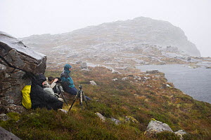Photographers above Coire nan Arr in bad weather, Wester Ross, Scotland, October  -  Niall Benvie