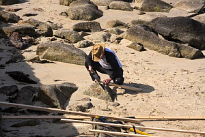 """Man making stretchers for Cornish Pilot Gig """"Kathrin Rose"""" on Town Beach, St. Mary's, Isles of Scilly. World Pilot Gig Championships, May 2009. - Merryn Thomas"""