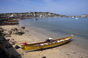 """Men fixing stretchers of Cornish Pilot Gig """"Kathrin Rose"""" pulled up on Town Beach, St. Mary's, Isles of Scilly. World Pilot Gig Championships, May 2009. - Merryn Thomas"""