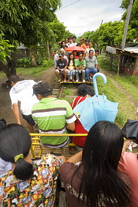 Commuters travelling on 'skates' - a local form of transport in Manila, Philippines. A motorized platform that can hold up to 30 people and runs on the railway tracks. When the skate meets another hea...  -  Jurgen Freund