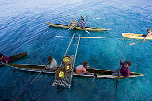 Papuans in traditional dug-out fishing canoes, Papua New Guinea. 2008  -  Jurgen Freund