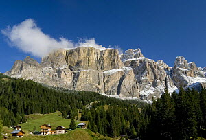 Fresh-fallen snow in the Sella Group with mountain chalets in foreground, Dolomite Alps, Italy, September 2008 - Martin Gabriel