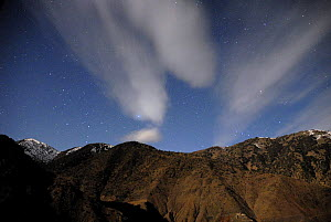 High Atlas Mountains at night in moonlight with stars, Azzadene Valley, Moroco. March 2006. - Tim Martin