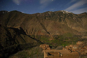 Azzadene Valley at night, in moonlight with stars. High Atlas Mountains, Morocco, March 2006. - Tim Martin