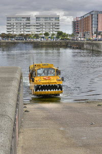 The Yellow Duck (DUKW) emerges from the salthouse Dock, as part of the circular tour of Liverpool's Waterfront. August 2009. - Graham Brazendale