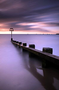 Groyne and view looking out to sea at dawn, Swanage Bay, Dorset, UK. April 2009.  -  Ross Hoddinott