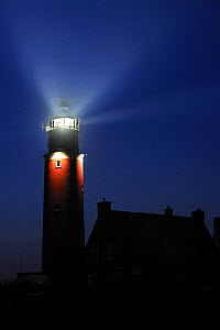 The Cocksdorp lighthouse shining at night, Texel, the Netherlands, April 2009  -  Philippe Clement