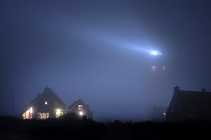 The Cocksdorp lighthouse shining at night in thick fog, Texel, the Netherlands, April 2009  -  Philippe Clement