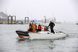 """""""Sonar"""" dismasted, being recovered by a safety boat. Cowes Week, August 2009.  -  Rick Tomlinson"""