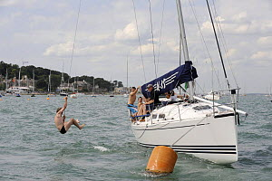"""Man swinging from a rope off """"Turbulence II"""", Cowes Week, August 2009. - Rick Tomlinson"""