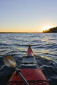 A kayak at dawn on Lake Winnipesauke in Meredith, New Hampshire, USA. October 2008  -  Jerry Monkman