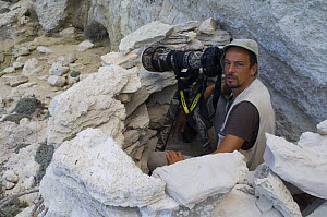 Photographer, Stefano Unterthiner, in stone hide to photograph Eleonora's falcons (Falco eleonorae) Antikythera, Greece, September 2008  -  Wild Wonders of Europe / Unterthiner