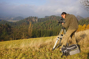 Cameraman, Alberto Saiz, filming for Wild Wonders of Europe, with Mariina Skala in the distance, Rynartice, Ceske Svycarsko / Bohemian Switzerland National Park, Czech Republic, November 2008  -  Wild Wonders of Europe / Ruiz