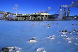 People bathing in the spa waters of the Blue Lagoon with the geothermal power plant in the background, Grindavik, Iceland 2005  -  Jouan & Rius