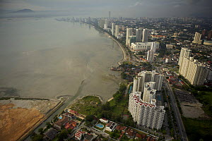 Aerial view of the waterfront of Georgetown, Penang, Malaysia and new coastal development. Georgetown, Pulau Pinang, Malaysia. May 2006  -  Tim Laman