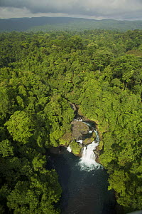 Aerial view of waterfall and rain forest near Punta Dolores, south coast region of Bioko Island, Equatorial Guinea, Central Africa. January 2008  -  Tim Laman