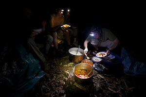 Expedition members serve themselves dinner of rice and red sauce with sardines and spam, Bioko Island, Equatorial Guinea, Rapid Assessment Visual Expedition, International League of Conservation Photo...  -  Tim Laman