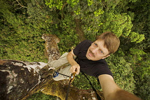 Self portrait of Photographer, Tim Laman, climbing an emergent mahogany tree in the Gran Caldera Volcanica de Luba, Bioko Island, Equatorial Guinea, Rapid Assessment Visual Unit, International League...  -  Tim Laman