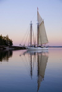 "Maine cruise schooner ""Isaac H. Evans"" at sunset, Jericho Bay, Maine. September 2007. Model and Property Released. - Benjamin Mendlowitz"