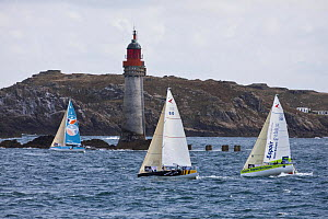 Fleet sailing past the Phare du Grand-Jardin, Saint Malo, during the Tour de Bretagne, September 2009. - Benoit Stichelbaut