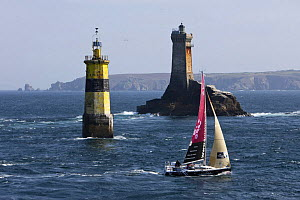 """Luisina"" (Eric Drouglazet and Laurent Pellecuer) passing marker and Phare De La Vieille (Lighthouse) at Raz De Sein, Finistere, Brittany, during the Tour de Bretagne, September 2009. - Benoit Stichelbaut"