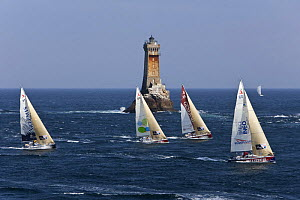Yachts passing lighthouse at Raz De Sein, Finistere, Brittany, during the Tour de Bretagne, September 2009. - Benoit Stichelbaut