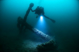 Diver with large anchor off the south coast, UK. September 2009. - Michael Pitts