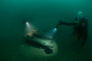 Divers at 30 meters, examining the exposed hull of an unknown wreck off the south coast, UK.. September 2009. - Michael Pitts