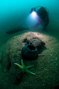 Diver at 30 meters, working near the exposed hull of an unknown wreck off the south coast, UK.. September 2009. - Michael Pitts
