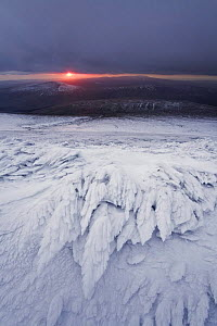View from the summit of Corn Du towards The Black Mountain in winter at sunset, hard rime ice formations in foreground, Brecon Beacons National Park, Powys, Wales, UK, October 2008  -  Guy Edwardes