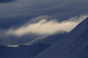 Low clouds over snow covered hills, Dovrefjell National Park, Norway, February 2009 - Wild Wonders of Europe / Munier