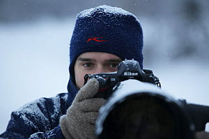 Photographer, Sven Zacek, with camera, in snow, Finland, February 2009  -  Wild Wonders of Europe / Zacek