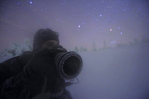 Photographer, Sven Zacek, in snow covered landscape at night, Riisitunturi National Park, Finland, February 2009  -  Wild Wonders of Europe / Zacek