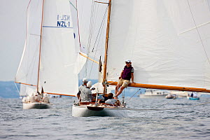 """Woman leaning against boom of yacht """"Clarity"""" during the 6 Metre Class World Championships, Newport, Rhode Island, USA. September 2009.  -  Onne van der Wal"""