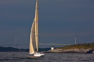 Yacht sailing past the Castle Hill lighthouse during the 12 Metre World Championships, Newport, Rhode Island, USA. September 2009.  -  Onne van der Wal