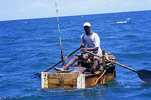 Fisherman fishing by hand line for squid, Vilankulo, Mozambique, November 2008  -  Jeff Rotman