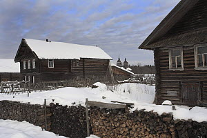 Snow covered houses in traditional Russian village, Chistyi Dor, Russky Sever NP, Vologda Province, Russia, March 2009  -  Konstantin Mikhailov
