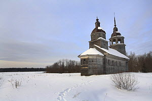 Snow covered wooden church in traditional Russian village of Chistyi Dor, Russky Sever NP, Vologda Province, Russia, March 2009  -  Konstantin Mikhailov