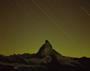 Matterhorn (4,478m) at night, long exposure with star trails, viewed from Gornergrat, Switzerland, September 2008, climbers in foreground with headlamps setting off to climb the Matterhorn from Hornli...  -  Wild Wonders of Europe / Popp-Ha
