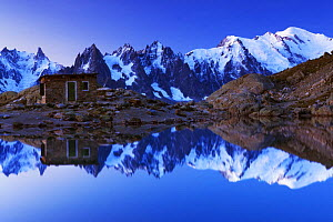 Aiguilles de Chamonix with Mont Blanc (4,810m) right, reflected in Lac Blanc with small mountain hut at dawn, Haute Savoie, France, Europe, September 2008 - Wild Wonders of Europe / Krahmer