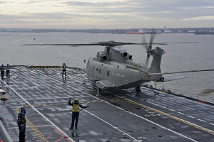 """Merlin HM Mk 1 ASW helicopter prior to take off from HMS """"Illustrious"""", in Liverpool for Fly Navy 100 Day (100 years of Naval Aviation). Liverpool, Merseyside, England, October 2009.  All non-editoria... - Graham Brazendale"""