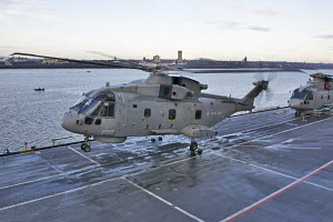 """Merlin HM Mk 1 ASW helicopter taking off from HMS """"Illustrious"""", in Liverpool for Fly Navy 100 Day (100 years of Naval Aviation). Liverpool, Merseyside, England, October 2009.  All non-editorial uses... - Graham Brazendale"""