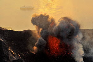 Eruption on Stromboli Volcano with a boat on the sea, Aeolian Islands, Italy, May 2009  -  Wild Wonders of Europe / Grunewald