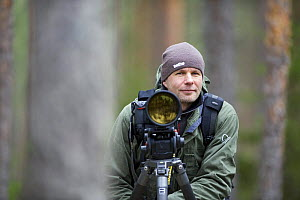 Photographer, Erlend Haarberg with camera equipment, in Bergslagen, Sweden, April 2009  -  Wild Wonders of Europe / E. Haarberg