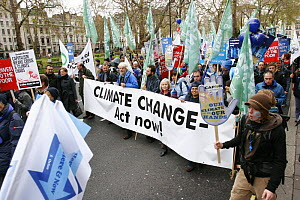 The Wave, climate change march ahead of the Copenhagen climate summit. People carrying large banner stating 'Climate Change - Act Now' London, UK, 5th December 2009  -  Tom Gilks