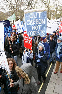Protesters part of 'The Wave' climate change march ahead of the Copenhagen climate summit, one sign stating 'Cut Carbon not Forests' London, UK, 5th December 2009  -  Tom Gilks