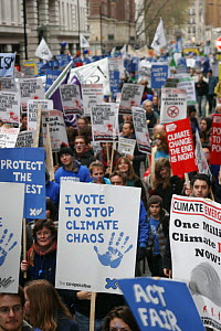 "Protesters carrying banners including ""I vote to stop climagte chaos"", part of 'The Wave' climate change march ahead of the Copenhagen climate summit, London, UK, 5th December 2009  -  Tom Gilks"